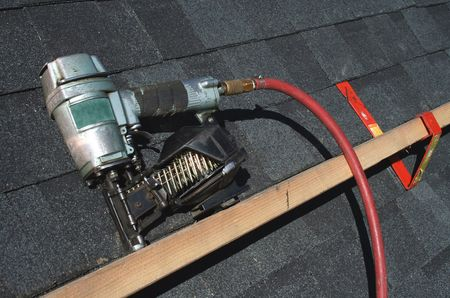 pneumatic: A Pneumatic roofing nail gun with air hose
