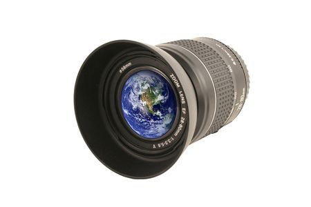 zoom earth: A Camera lens with the earth in the glass Stock Photo