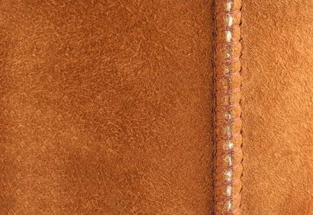 suede: Brown suede background with seam