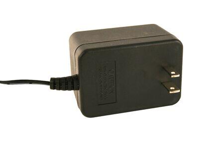 A Isolated AC adaptor plug on white Фото со стока