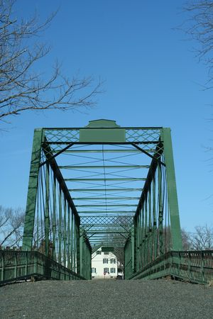 covered bridge: A Old metal bridge against a blue sky Stock Photo