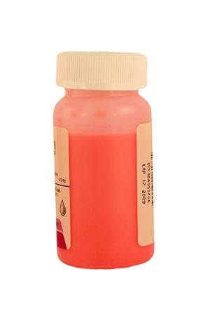 A Isolated childrens pink medicine bottle Stock fotó