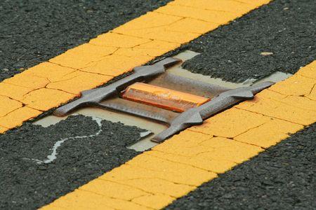 lane marker: A Road reflector lane marker in the street