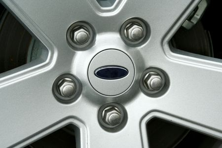 a Car tire wheel and lug nuts IMAGE Stock Photo - 2890764