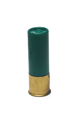 A Isolated 12 gage green shotgun shell