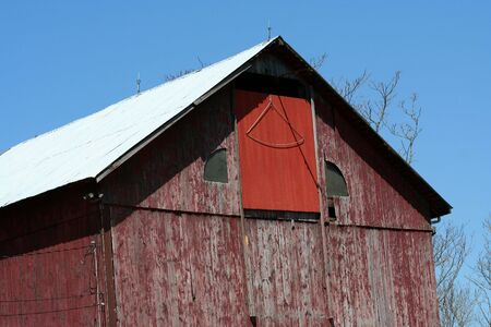old red barn: A Old red barn against a blue sky