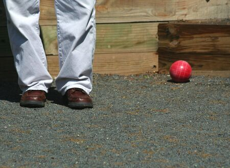 A Man playing bocce ball Imagens