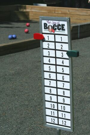 A Bocce ball score board on a court Imagens