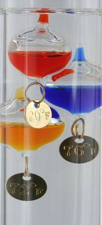 Close up of a glass Galileo thermometer