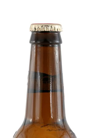 A Isolated brown beer bottle with cap