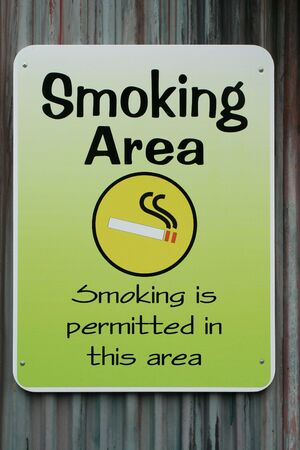 permitted: A Smoking permitted in this area sign