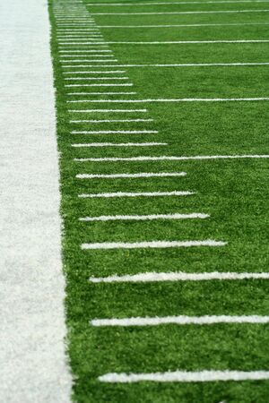 White Football Yard Markers on astro turf Stock Photo