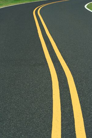 yellow line: A Curvy road with double yellow line Stock Photo