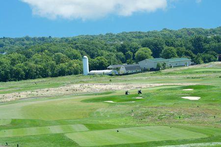ファームではバック グラウンドでゴルフ コース 写真素材