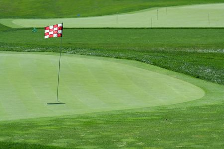A Glof flag on a green with fairway Stock Photo - 3592914