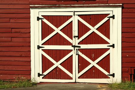 A pair of Old red bard doors Stock Photo
