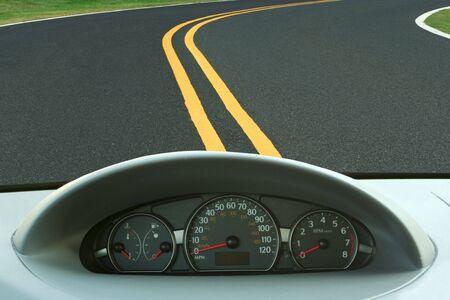 Car dashboard and curvy road