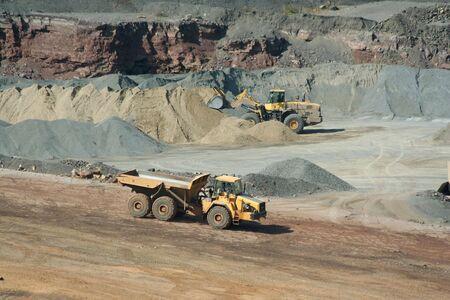A Dump truck working at a rock quarry