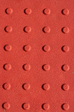 non: A Red sidewalk non slip pad background
