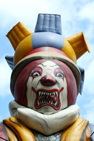 blow up: Blow up scary clown against blue sky