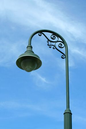 Vintage green lamp post against blue sky Stock Photo