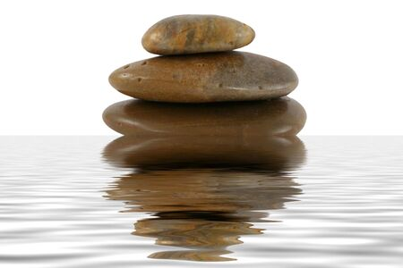 A Stack of zen rocks with water reflection