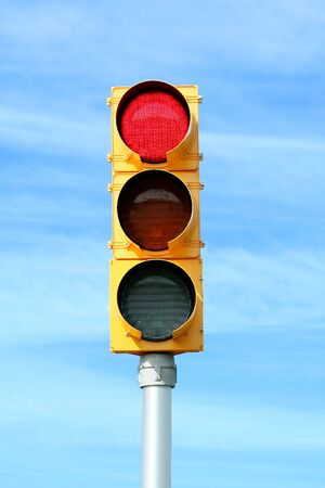 Red traffic signal light on blue sky Stock Photo