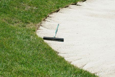 A Sand trap rake in a bunker