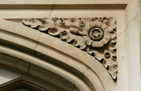 A old flower carving on a doorway
