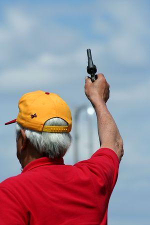 Man firing the starting gun for a race Stock Photo - 4848258