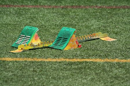 A set of starting block in the grass Stock Photo - 4848263