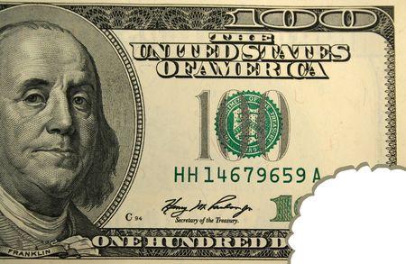Honderd dollar bill met een hap genomen uit Stockfoto