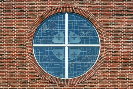 Stained glass windows with brick background photo