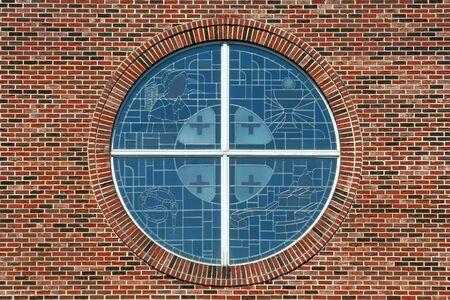 stained glass windows: Stained glass windows with brick background Stock Photo