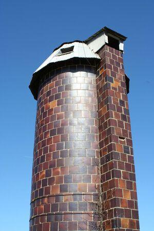A old silo against blue sky photo