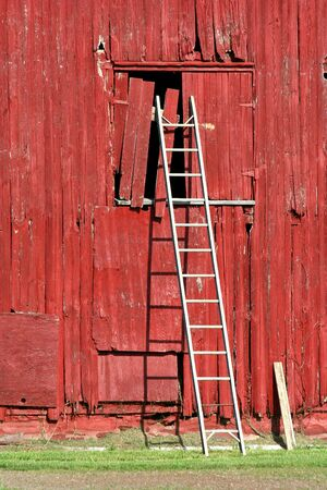 A ladder on a old red bard photo