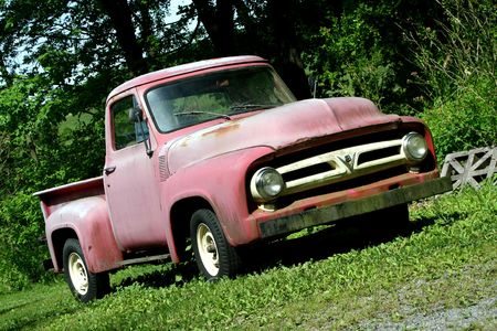 A Vintage red pickup truck Stock Photo