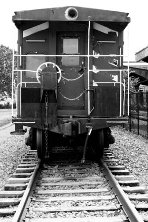 caboose: a Rear view of a train caboose