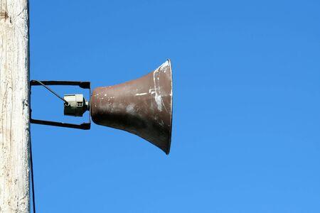 A Loudspeaker against blue sky   photo