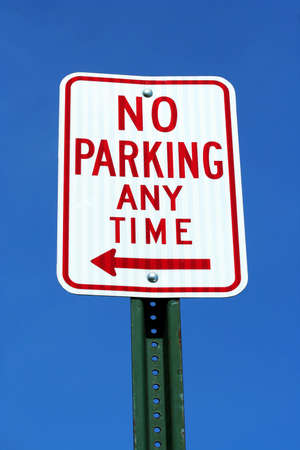 parking violation: No Parking sign with blue sky Stock Photo