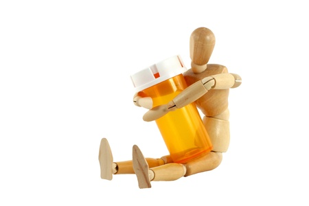 A manikin with pill bottle photo