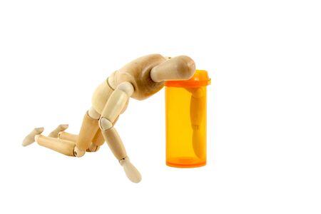 A Manikin reaching in pill bottle photo