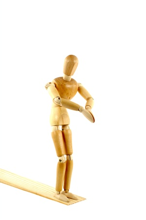 wood figurine: A manikin on a diving board Stock Photo