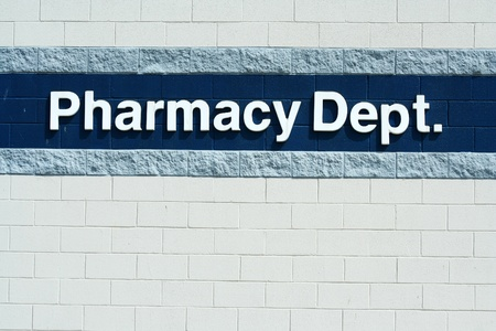 dept: A Pharmacy Dept sign on a wall