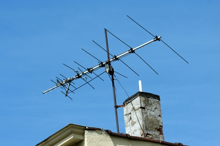 TV antenna on the roof of a building