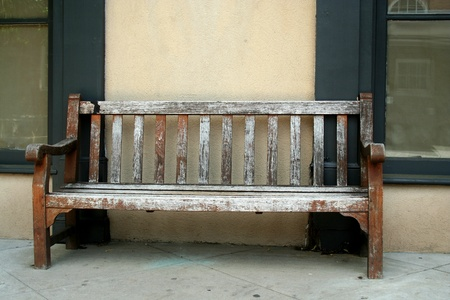 Old wodden bench on a sidwalk Stock Photo - 13558424