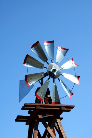 A windmill against blue sky