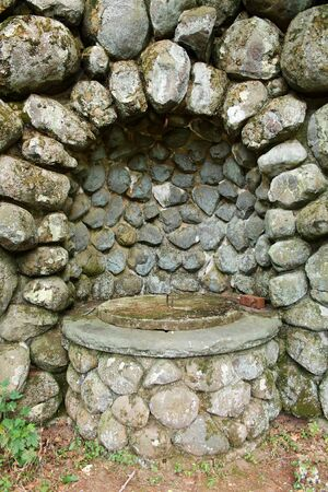 round: A Old stone well with structure