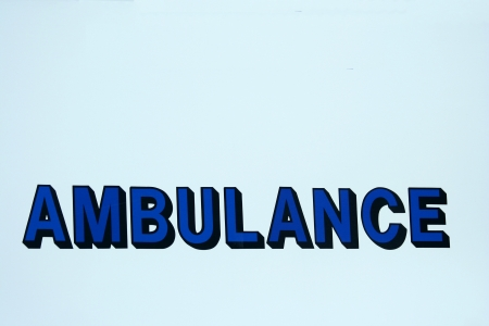 A Ambulance sign on a empty background Stok Fotoğraf