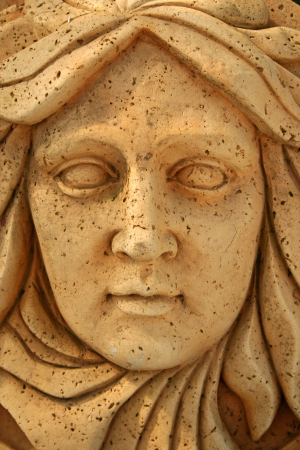 A close up of a statue face
